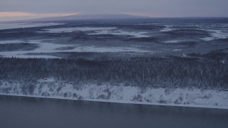 AK0001_1663 - 4K stock footage aerial video flying over snow covered woods of Point MacKenzie at twilight, Alaska