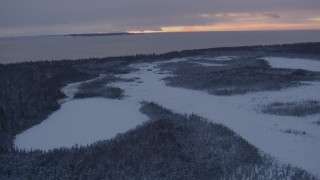 AK0001_1664 - 4K stock footage aerial video Fire Island seen from snow covered Point MacKenzie at twilight, Alaska