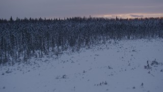 AK0001_1672 - 4K stock footage aerial video flying low over frozen, snowy ground at sunset, Point MacKenzie, Alaska