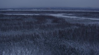AK0001_1679 - 4K stock footage aerial video Downtown Anchorage seen from snowy Point MacKenzie at twilight, Alaska