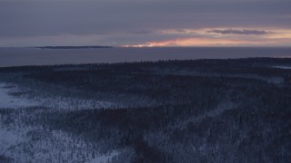 AK0001_1684 - 4K stock footage aerial video twilight lit clouds seen from snow covered Point MacKenzie, Alaska