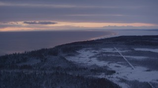 AK0001_1688 - 4K stock footage aerial video twilight lit clouds, forests on snow covered Point MacKenzie, Alaska