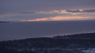 AK0001_1689 - 4K stock footage aerial video twilight lit clouds over Cook Inlet seen from snow covered Point MacKenzie, Alaska