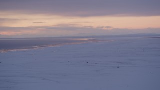 AK0001_1691 - 4K stock footage aerial video twilight lit clouds over snow covered Point MacKenzie and Cook Inlet, Alaska