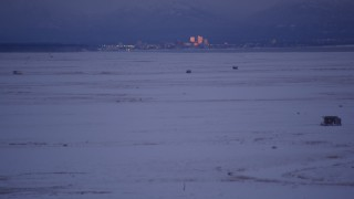 AK0001_1712 - 4K stock footage aerial video tilt to reveal Downtown Anchorage, seen from Point MacKenzie, Alaska, twilight