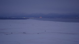 AK0001_1713 - 4K stock footage aerial video Downtown Anchorage seen from snowy Point MacKenzie, Alaska, twilight