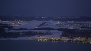 AK0001_1719 - 4K stock footage aerial video snow covered Elmendorf Air Force Base at night, Anchorage, Alaska