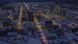 AK0001_1721 - 4K stock footage aerial video fly over icy shore of Cook Inlet and snowy Downtown Anchorage, Alaska, night