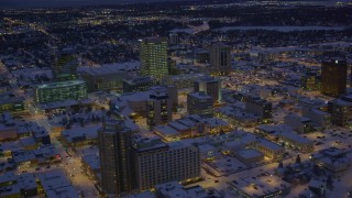 AK0001_1722 - 4K stock footage aerial video orbiting snow covered Downtown Anchorage at night, Alaska