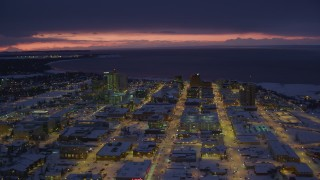 AK0001_1725 - 4K stock footage aerial video a view of snow covered Downtown Anchorage at night, Alaska