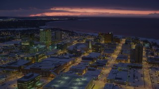 AK0001_1726 - 4K stock footage aerial video flying over snow covered Downtown Anchorage at night, Alaska