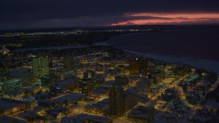 AK0001_1732 - 4K stock footage aerial video flyby snow covered Downtown Anchorage at night, Alaska