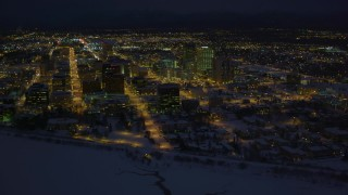 AK0001_1734 - 4K stock footage aerial video snowy Downtown Anchorage buildings near the shore of Cook Inlet, Alaska, night
