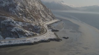 AK0001_1741 - 4K stock footage aerial video approaching Seward Highway on the snowy shore of the Turnagain Arm, Alaska