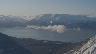 AK0001_1746 - 4K stock footage aerial video snowy Kenai Mountains across from Turnagain Arm of the Cook Inlet, Alaska