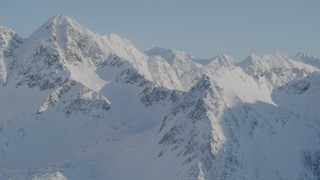 AK0001_1752 - 4K stock footage aerial video snow covered sharp ranges and peaks in the Chugach Mountains, Alaska