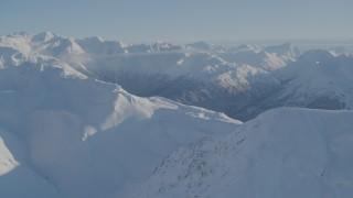 AK0001_1754 - 4K stock footage aerial video flying by snowy mountain ridge in Chugach Mountains, Alaska