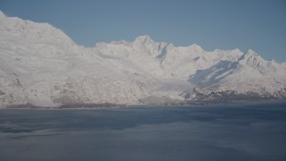 AK0001_1786 - 4K stock footage aerial video a small, snow covered glacier spilling into the Harriman Fjord, Alaska