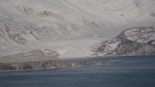 AK0001_1788 - 4K stock footage aerial video a small, snow covered glacier spilling into the Harriman Fjord, Alaska