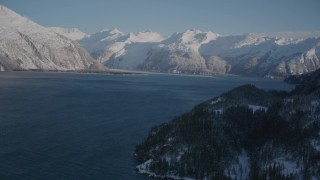 AK0001_1789 - 4K stock footage aerial video fly along snowy shore of Harriman Fjord toward Chugach Mountains, Alaska