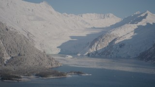 AK0001_1790 - 4K stock footage aerial video snowy glacier spilling down Chugach Mountains into Harriman Fjord, Alaska