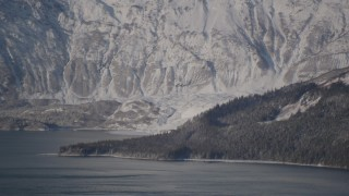AK0001_1791 - 4K stock footage aerial video flying away from a snow covered glacier spilling into the Harriman Fjord, Alaska