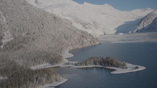 AK0001_1792 - 4K stock footage aerial video descending toward surface of Harriman Fjord, past snowy slopes, Alaska