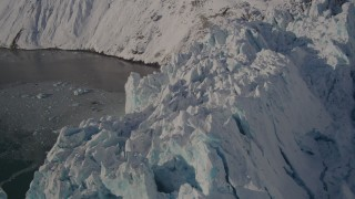 AK0001_1800 - 4K stock footage aerial video the jagged edge of a snow covered glacier, Harriman Fjord, Alaska