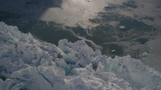 AK0001_1801 - 4K stock footage aerial video bird's eye view of the jagged edge of a snow covered glacier on the Harriman Fjord, Alaska
