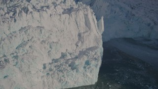 AK0001_1803 - 4K stock footage aerial video the jagged edge of the snow covered glacier at end of Harriman Fjord, Alaska