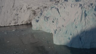 AK0001_1805 - 4K stock footage aerial video the edge of a snow covered glacier on the Harriman Fjord, Alaska