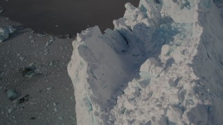 AK0001_1808 - 4K stock footage aerial video bird's eye view of the edge and rough surface of snow covered glacier on Harriman Fjord, Alaska