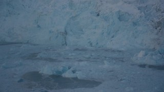 AK0001_1815 - 4K stock footage aerial video approaching glacial ice floating in Harriman Fjord, Alaska in snow