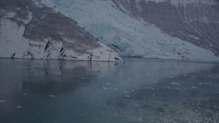 AK0001_1821 - 4K stock footage aerial video flying low over surface of Harriman Fjord toward snow covered glacier, Alaska