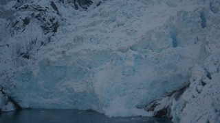 AK0001_1822 - 4K stock footage aerial video the ragged edge of a snow covered glacier in Harriman Fjord, Alaska