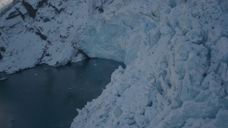 AK0001_1823 - 4K stock footage aerial video the edge of a snow covered glacier on Harriman Fjord, Alaska