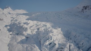 AK0001_1824 - 4K stock footage aerial video ascend a snowy glacier spilling down mountain slope, Harriman Fjord, Alaska