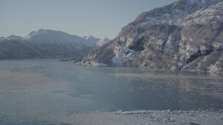 AK0001_1827 - 4K stock footage aerial video fly over surface of water, Harriman Fjord surrounded by snowy mountains, Alaska