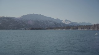 AK0001_1830 - 4K stock footage aerial video flying low over surface of water in Harriman Fjord, Alaska in snow