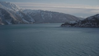 AK0001_1832 - 4K stock footage aerial video approach mouth of Harriman Fjord at base of snowy mountains, Alaska