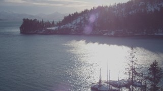 AK0001_1835 - 4K stock footage aerial video flying over small, snowy island in Port Wells, Alaska