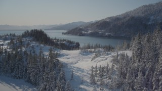 AK0001_1858 - 4K stock footage aerial video flying over snowy and forested hills, Port Wells, Alaska