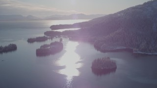 AK0001_1873 - 4K stock footage aerial video snow covered islands at mouth of Hummer Bay, Port Wells, Alaska