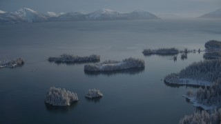AK0001_1874 - 4K stock footage aerial video small, snowy islands at mouth of Hummer Bay, Port Wells, Alaska