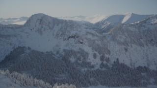 AK0001_1875 - 4K stock footage aerial video flying over snowy ridge revealing Chugach Mountains, Port Wells, Alaska