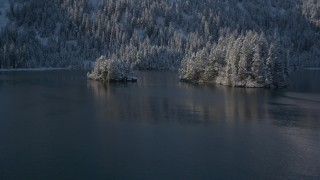 AK0001_1884 - 4K stock footage aerial video flying low over Port Wells and between two snowy islands, Alaska
