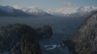 AK0001_1901 - 4K stock footage aerial video low clouds over snowy Chugach Mountains, Passage Canal, Alaska