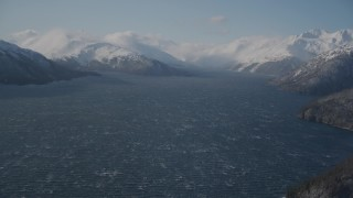 AK0001_1903 - 4K stock footage aerial video cloud, snow covered Chugach Mountains, Passage Canal, Alaska