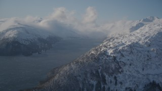 AK0001_1907 - 4K stock footage aerial video Passage Canal surrounded by snowy Chugach Mountains, Alaska