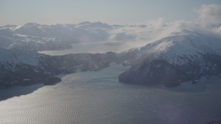 AK0001_1908 - 4K stock footage aerial video pan across Passage Canal, Shotgun Cove, snowy Chugach Mountains, Alaska